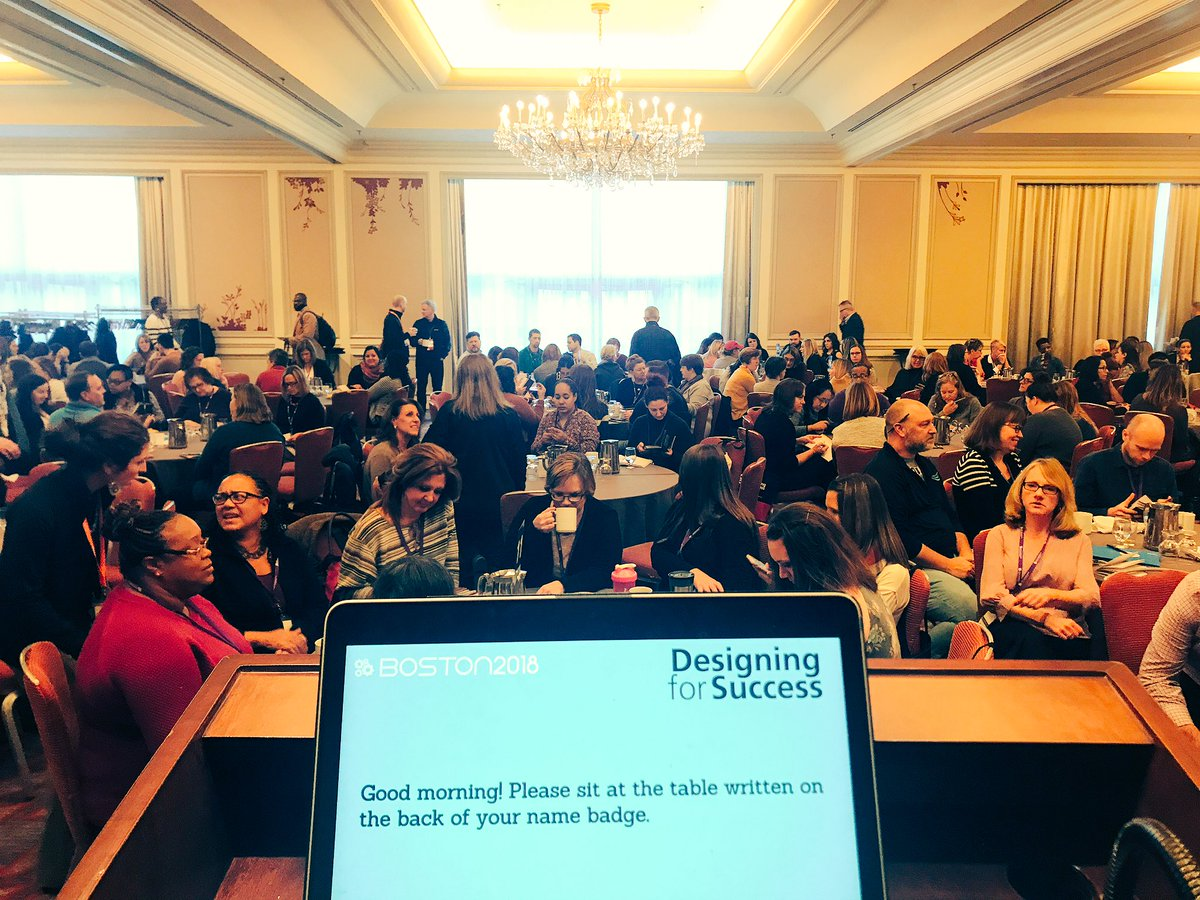 Attendees gather in the conference ballroom